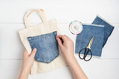 Old jeans reusing idea. Crafting with denim, recycling old clothers, hobby, diy activity.