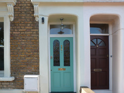 Period front door with stained glass