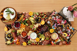 Antipasto table with extra desserts added