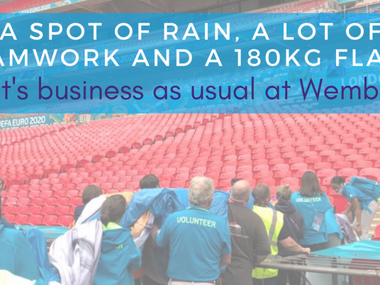 A spot of rain, a lot of teamwork and a 180kg flag... it's business as usual at Wembley