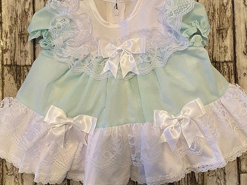 mint green frilly dress