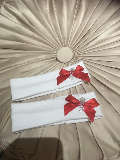 White headband with a red ribbon and jewelled bow