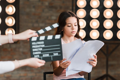 hand-holding-clapper-board-front-girl-re