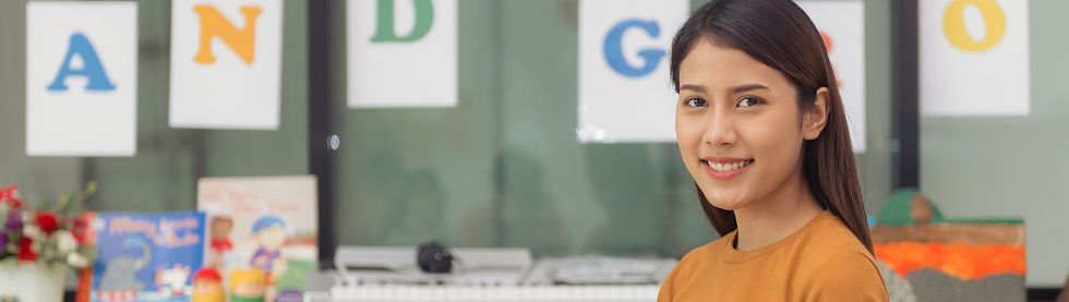 pretty-asian-teacher-smiling-camera-back