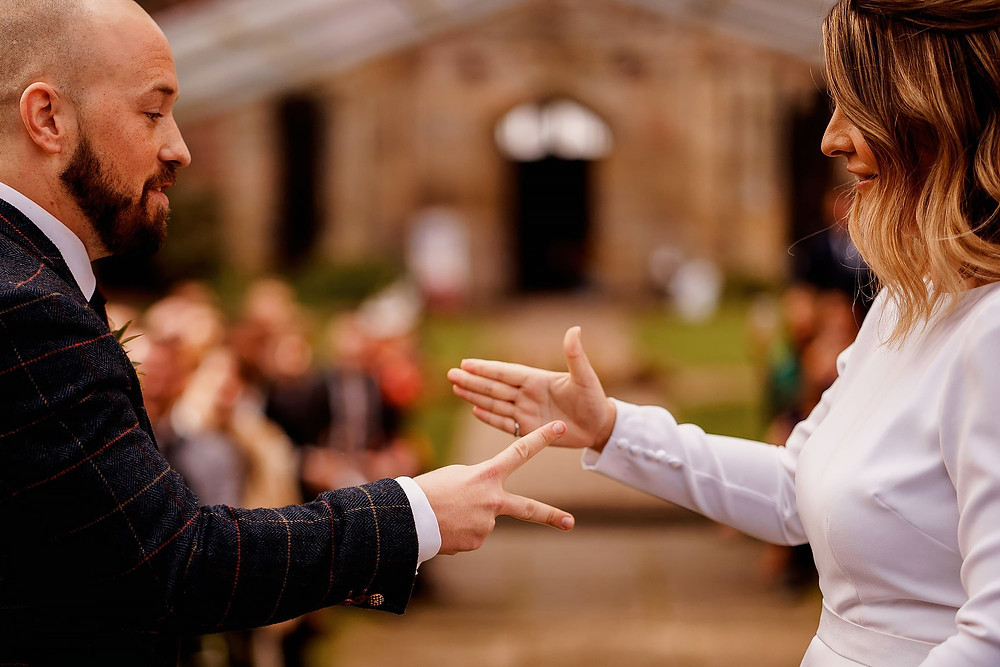 Lorraine Hull, Celebrant: A game of 'Rock, Paper, Scissors' to decide who makes their wedding vows first...