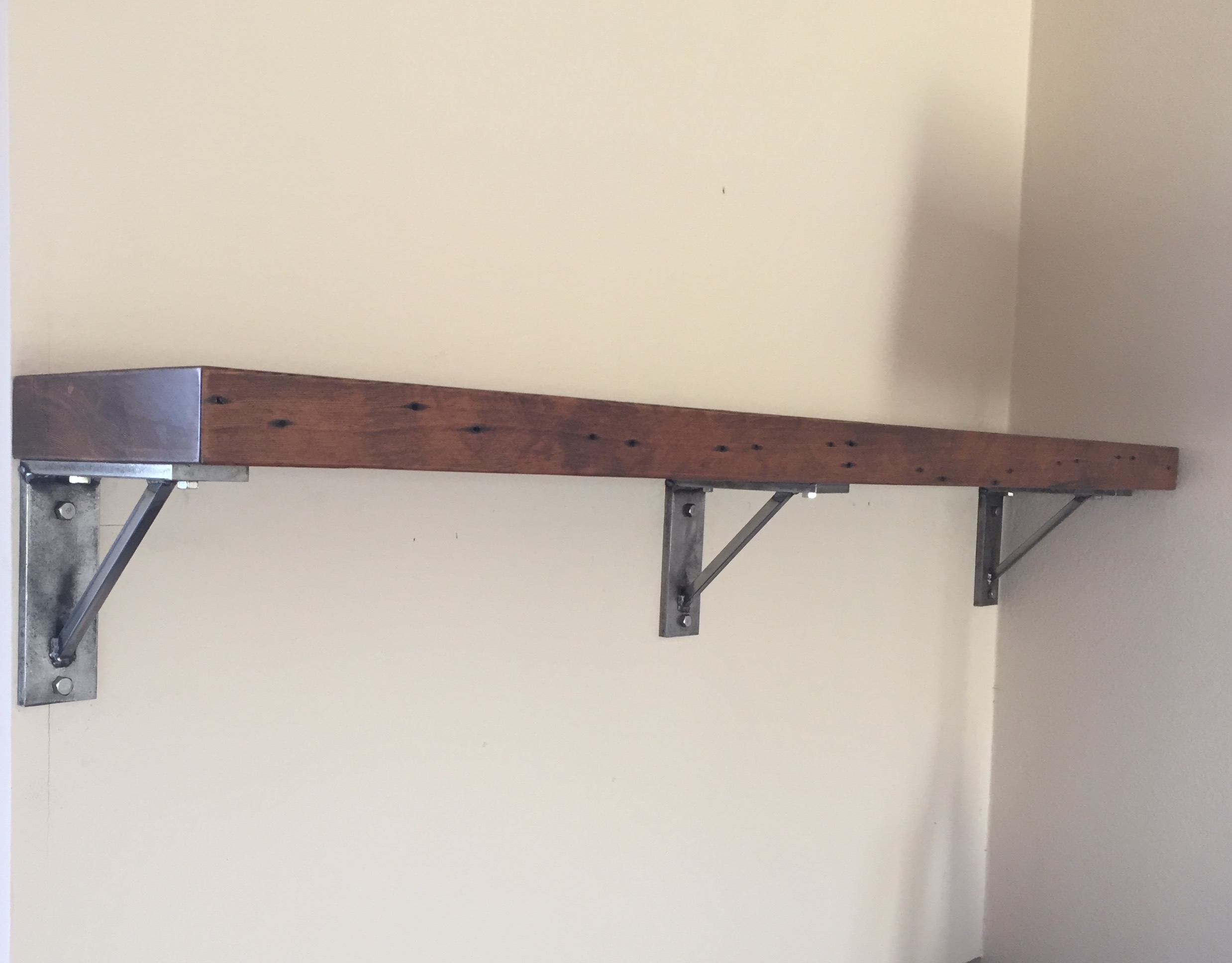 Mantel with steel brackets