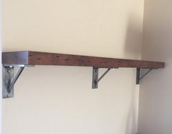 Mantel with steel brackets