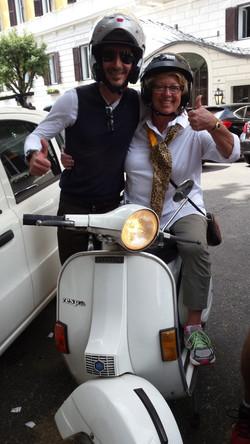 Riding a vespa in Rome!