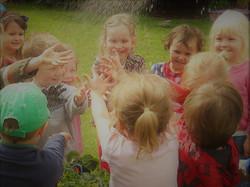 Children in nature gardening