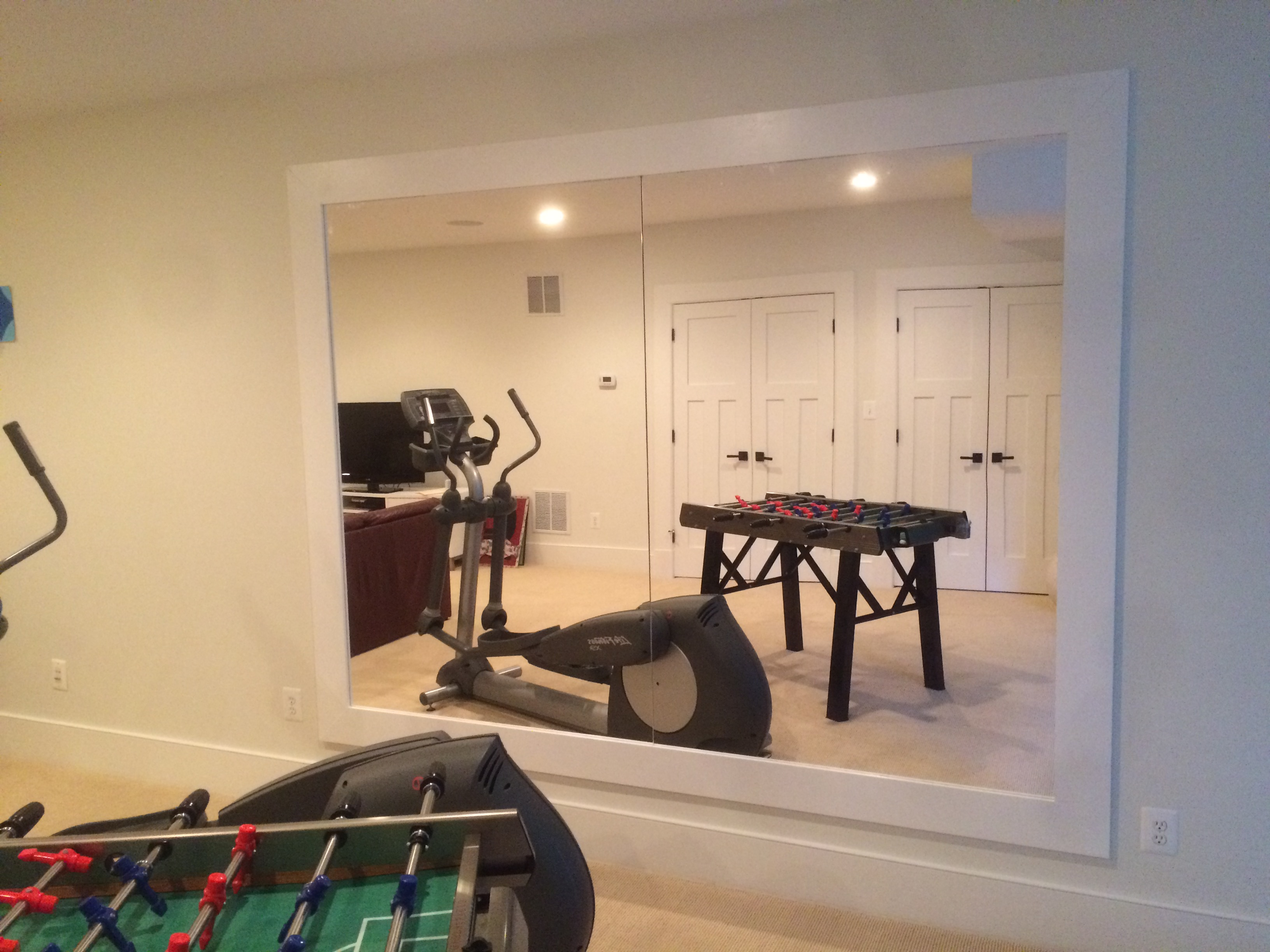Custom home gym mirror after