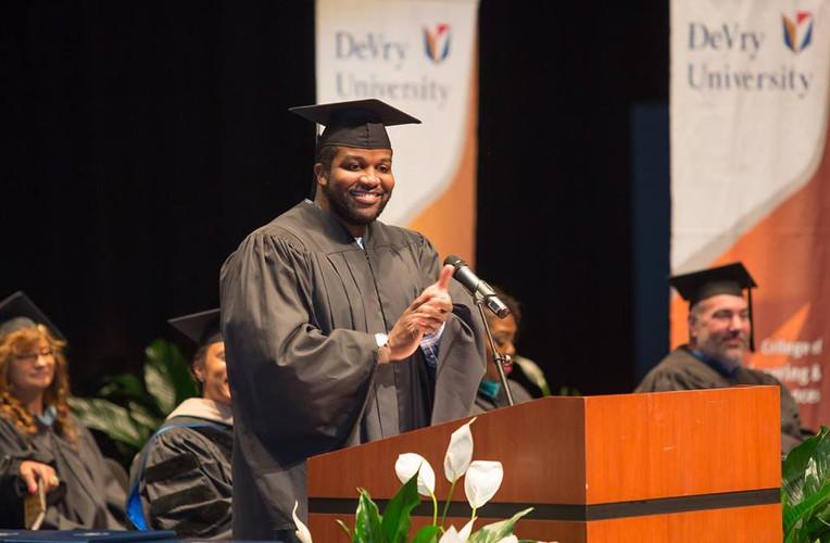 David Kendrick speaking at the DeVry University spring graduation in Atlanta, Ga