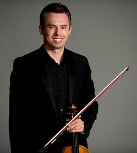 Photo of Adam Nelson, concertmaster