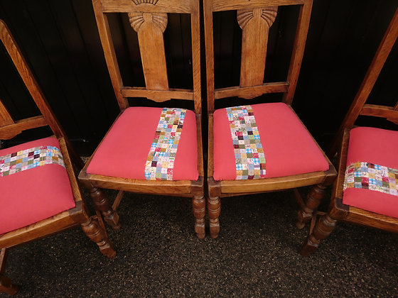 four dining chairs with appliqued stripe