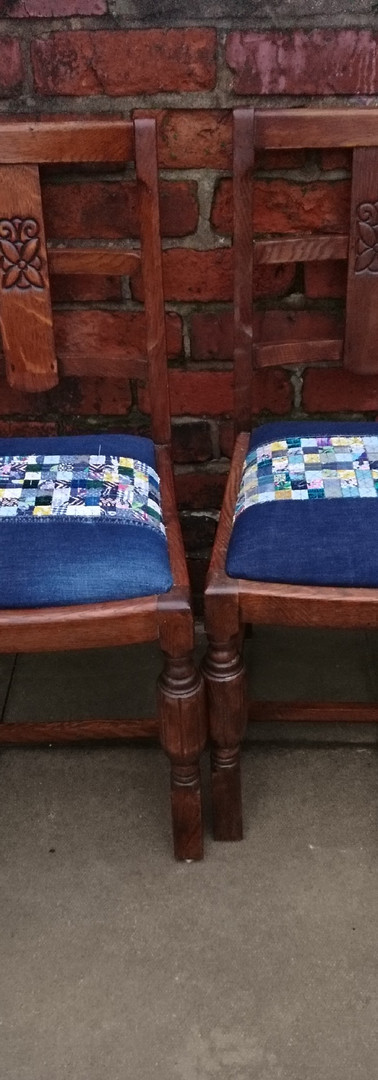 completed chairs reupholstered with handstitched cloth pieces over a flame retardent interlining and new stuffing