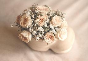 white rose flowers in white ceramic vase_edited.jpg