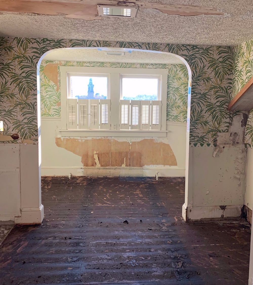Before Picture: Peeling wallpaper and water damage in a forgotten part of the old building