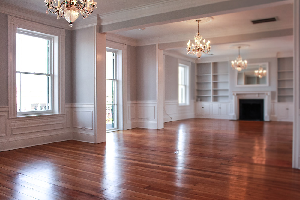 The newly restored ballroom at Piccadilly Place has three chandeliers, two fireplaces, and many windows