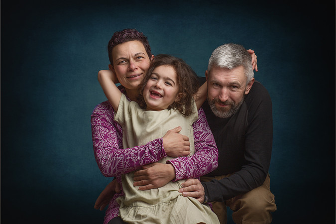 Studio family photography of parents with their girl, taken by Llanelli based photographer