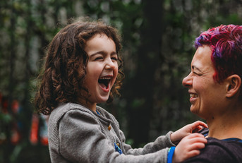 Outdoor natural photography of mother and daughter laughing in Penllergaer Woods, Swansea