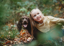 Family outdoor photography of a girl and her family dog in Penllergaer Woods, Swansea