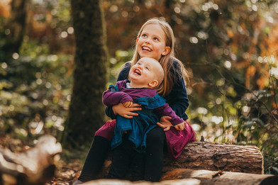 Family natural outdoor photograph of two sister in Autumn, in Penllergaer Woods, Swansea