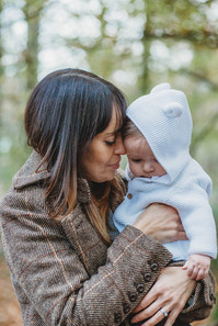 Natural outdoor photographer of a sweet moment between a mother and a baby, in Penllergaer Woods, Swansea