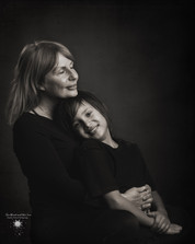 Black and white fine art family portrait of mother and son taken by Llaneli photographer