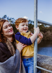 Outdoor natural family photograph of mother and son in Swiss Valley Reservoir, Llanelli