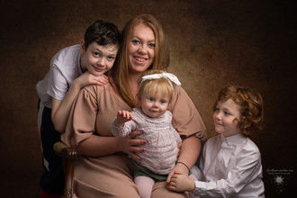 Family studio photograph of a mother with three children taken by Llanelli photographer