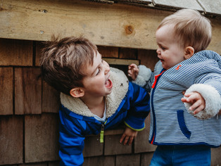 Natural photograph of two small brothers playing, taken by Llanelli photographer