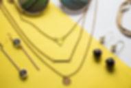 Silver jewelry on minimal yellow backgro