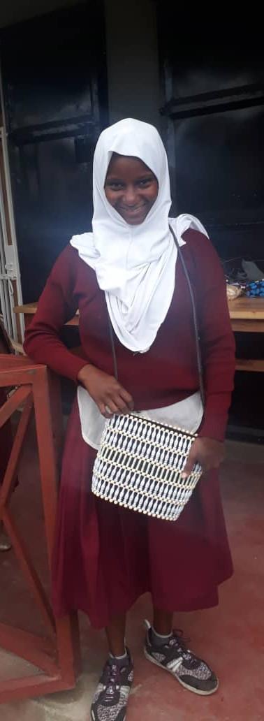 Shamin Showing off purse she made