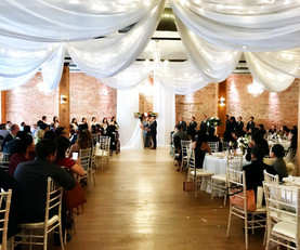 ceremony with vertical drape.jpeg