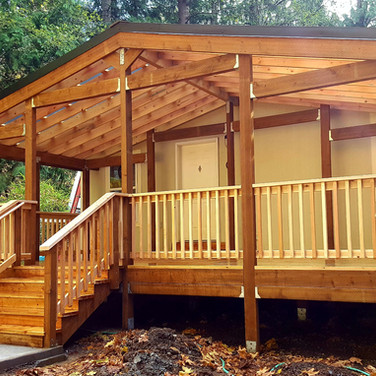 Cedar deck with gable cover.