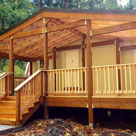 Cedar deck with gable cover.