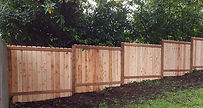 stair step sectional cedar fence.jpg