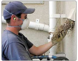 man cleaning dryr vent