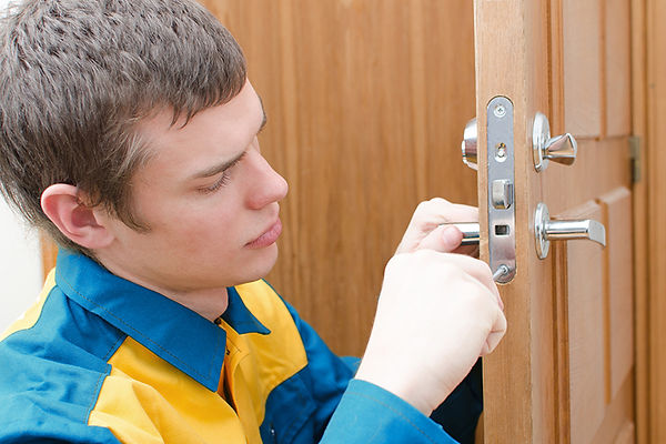 locksmith working, new home safety concerns, new house safety inspection, moving safety check, safety measures when moving in, how to make sure your new house is safe