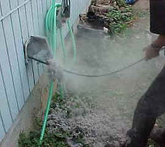 clogged clothes dryer vent being cleaned