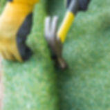artificial grass being fitted.jpg