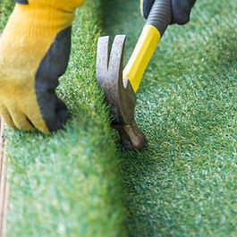 artificial grass being fitted.jpg