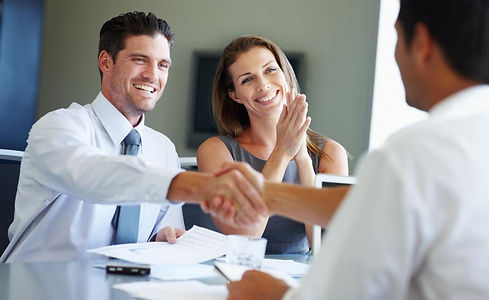 young-couple-reviewing-portfolio-with-financial-advisor-iStock-182030446.jpg