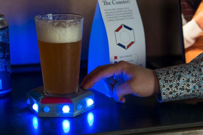 Back Home Bar coaster lit up with blue l