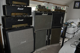 Wall of Marshalls inc. 100 watt Rockn Roll baby, 50 watt 2204.