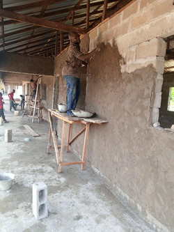 Applying Cement to the Block Walls