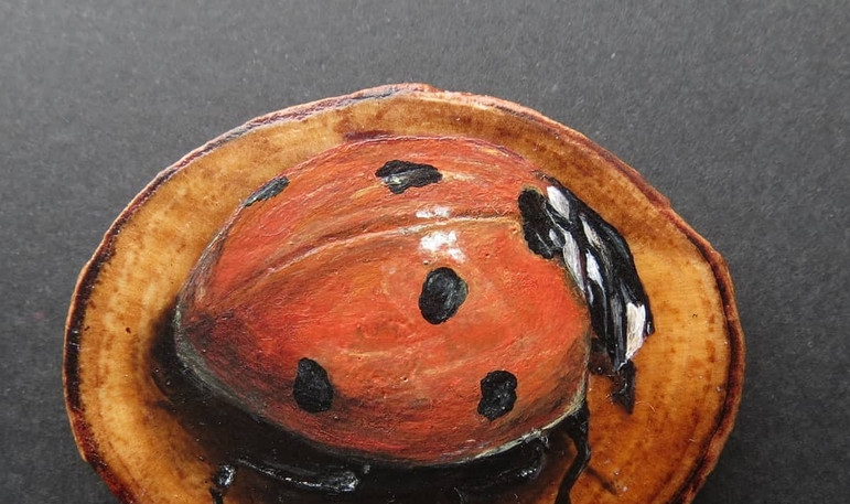 Acrylics on wood disc
