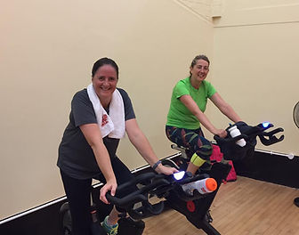 Two Scarab members of a spinning class