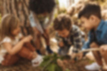 Kids-in-forest-with-a-magnifying-glass-1