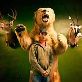 Taxidermist with bear