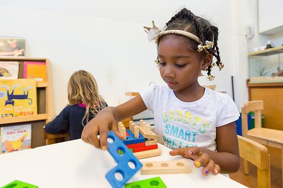 Montessori preschool child working